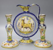 An Italian maiolica flask, height 30cm, and a pair of French faience candlesticks