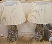 A pair of Chinese famille rose vases, mounted as lamps