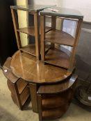 An Art Deco figured walnut nest of tables, n the manner of Epstein, diameter 74cm height 55cm