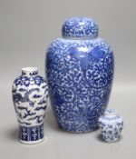 A Chinese blue and white 'lotus' jar and cover, early 20th century, a similar 'dragon' vase and a