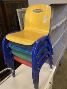A set of four metal and ply child's stacking chairs