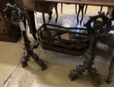 A Gothic revival cast iron fire grate, width 86cm, depth 46cm, height 73cm