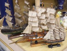 Three model ships: The Cutty Sark, The USS Constitution and Fragata, together with a carved wood