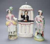 Three Staffordshire figures, one of Charles Spurgeon in the pulpit, height 31cm
