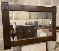 A Liberty rectangular carved oak wall mirror, width 91cm height 64cm