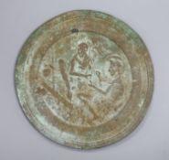 A Greek or Egyptian cast bronze roundel, diameter 18cm