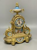 A Louis XVI style gilt spelter mantel clock inset Sevres style panels, height 38cm