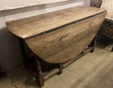 An 18th century oak gateleg dining table, 159cm extended, width 140cm height 78cm