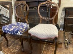 A set of six Victorian balloon back rosewood dining chairs