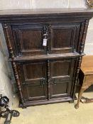 A 17th century style oak cupboard, width 100cm depth 42cm height 140cm