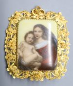 A 20th century filligree yellow metal mounted porcelain plaque pendant brooch, decorated with