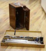 A mahogany cased microscope and veterinary equipment
