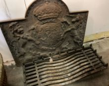 A 17th century style cast iron fire back, width 87cm, height 74cm and an iron grate (2)