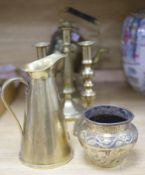 A Victorian brass spirit kettle on stand, two pairs of brass candlesticks and a jug