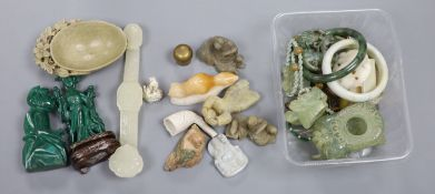 A collection of Chinese hardstone and soapstone figures, a RVI sceptre and various carved pendants