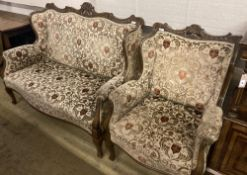 A late Victorian upholstered beech settee and armchair, settee width 130cm depth 66cm height 100cm