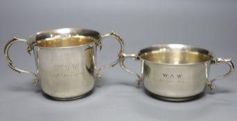 Two George V silver porringers, London, 1921 and Birmingham, 1925, tallest 8cm, gross 10oz.