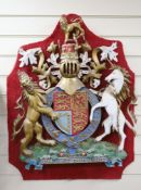 A carved wood and polychrome painted Royal armorial crest, overall length 84cm
