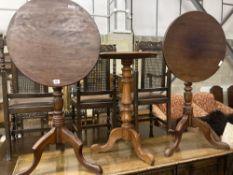 Three Victorian-style mahogany tripod wine tables, largest 49cm diameter