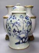 A pair of Chinese crackleglaze vases and a blue and white vase and cover, height 43cm