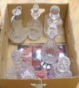 Five various glass decanters and a similar claret jug