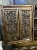 A late 19th century carved oak panel, width 72cm height 84cm