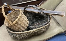 Three wicker baskets, a wirework basket and two baguette stands