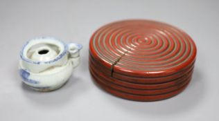 A Chinese red lacquer lidded box, diameter 12.5cm, and a blue and white water dropper