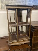 An Edwardian satinwood banded mahogany revolving bookcase, width 48cm height 89cm