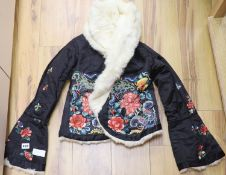 A Chinese black silk polychrome embroidered child's / ladies jacket, embroidered in Chinese knot and