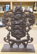 A cast iron armorial crest, height 70cm