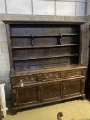 A George III oak and pine dresser, width 188cm depth 50cm height 204cm