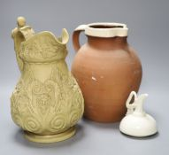An ornate 19th century jug, another and a cream glazed Worcester jug, tallest 29cm
