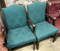 A pair of George III mahogany upholstered dining chairs (one with arms), width 62cm depth 52cm