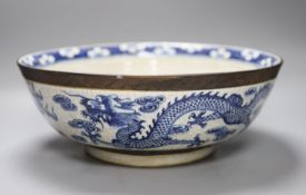 A large Chinese blue and white crackle glazed 'dragon' bowl, 19th century, diameter 37cm