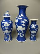 Three similar 19th/20th century Chinese blue and white vases, tallest 30cm