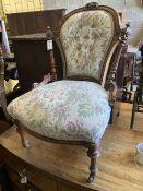 A Victorian carved walnut spoon back nursing chair, width 54cm, depth 56cm, height 80cm