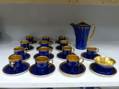 A Crown Devon Fieldings part coffee service, cobalt blue with gilt interiors and patterned rims,