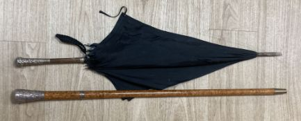 An Indian silver mounted walking cane, 91cm, and a silver mounted umbrella