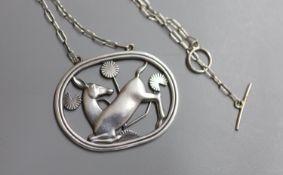 A Georg Jensen 925 'kneeling deer' oval pendant necklace, design no. 95, 42mm, gross 14.6 grams.