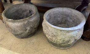 A pair of reconstituted stone circular garden planters, diameter 36cm, height 26cm