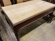 A Victorian mahogany rectangular kitchen table with associated beech top, length 150cm, depth