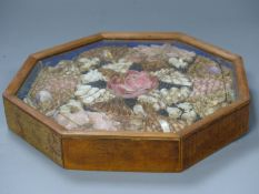 A Victorian framed sailors shell mosaic picture, octagonal frame, overall 25cm