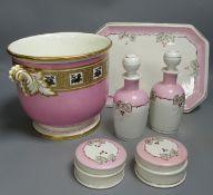 A Paris porcelain pink ground cache pot and a similar dressing table set, largest 27cm