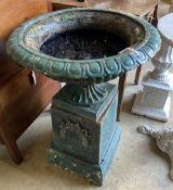 A Victorian green painted cast iron campana garden urn and pedestal, diameter 54cm, height 74cm