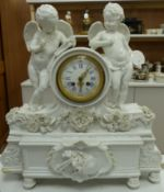 A large French porcelain white glazed 'cherub' mantel clock, height 49cm
