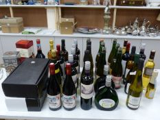 A large quantity of mixed wines, spirits and liqueurs including a 12 year Chivas Regal