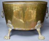 A planished brass wine cooler or jardiniere, approximate length 45cm