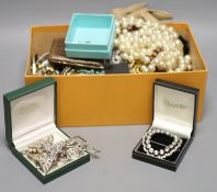 A quantity of assorted costume jewellery including necklaces and paste set brooches etc.