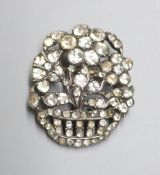 A white metal and paste set giardinetto brooch, 33mm.